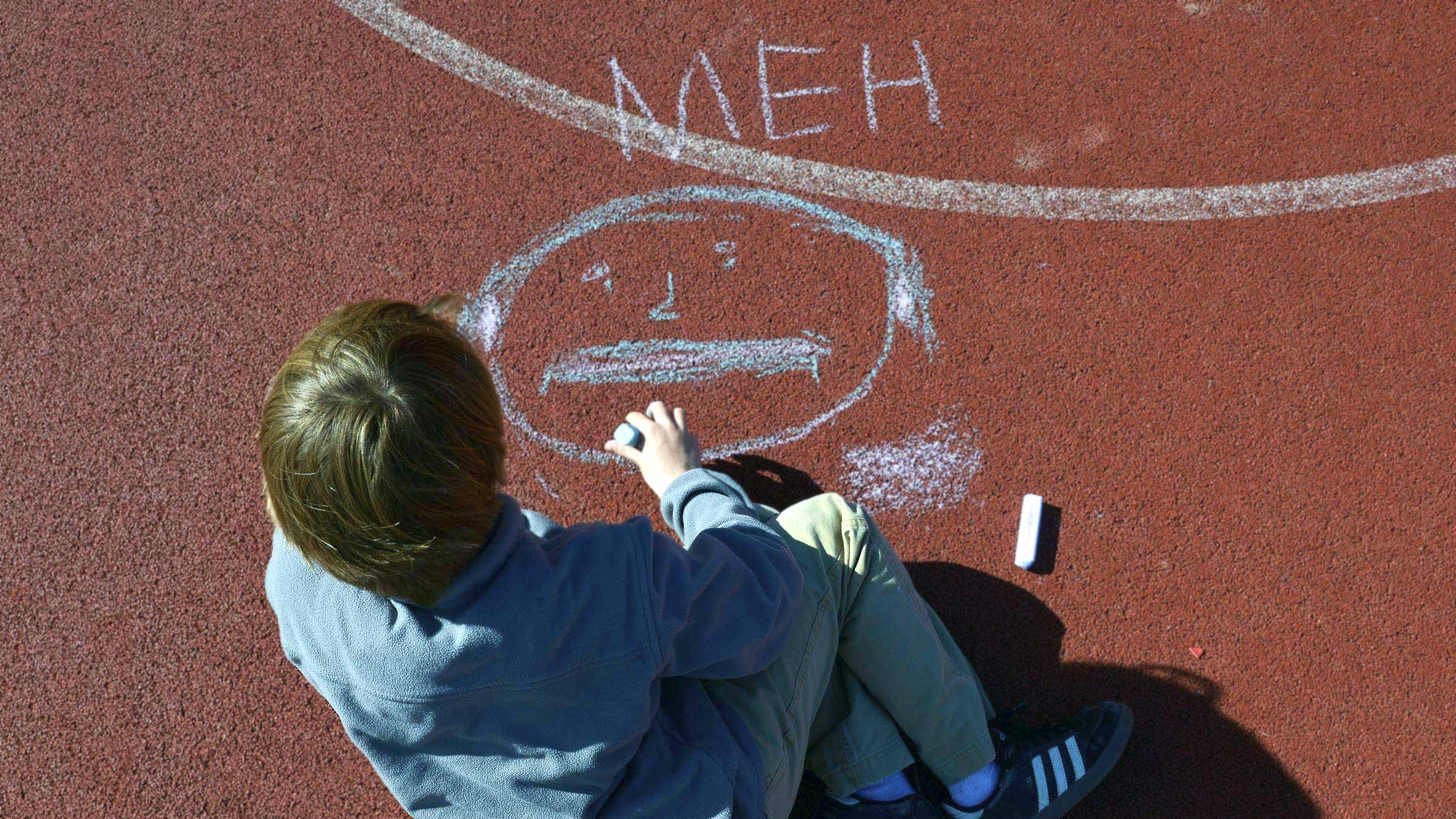 Elementary School children draw out their emotions during a therapy session