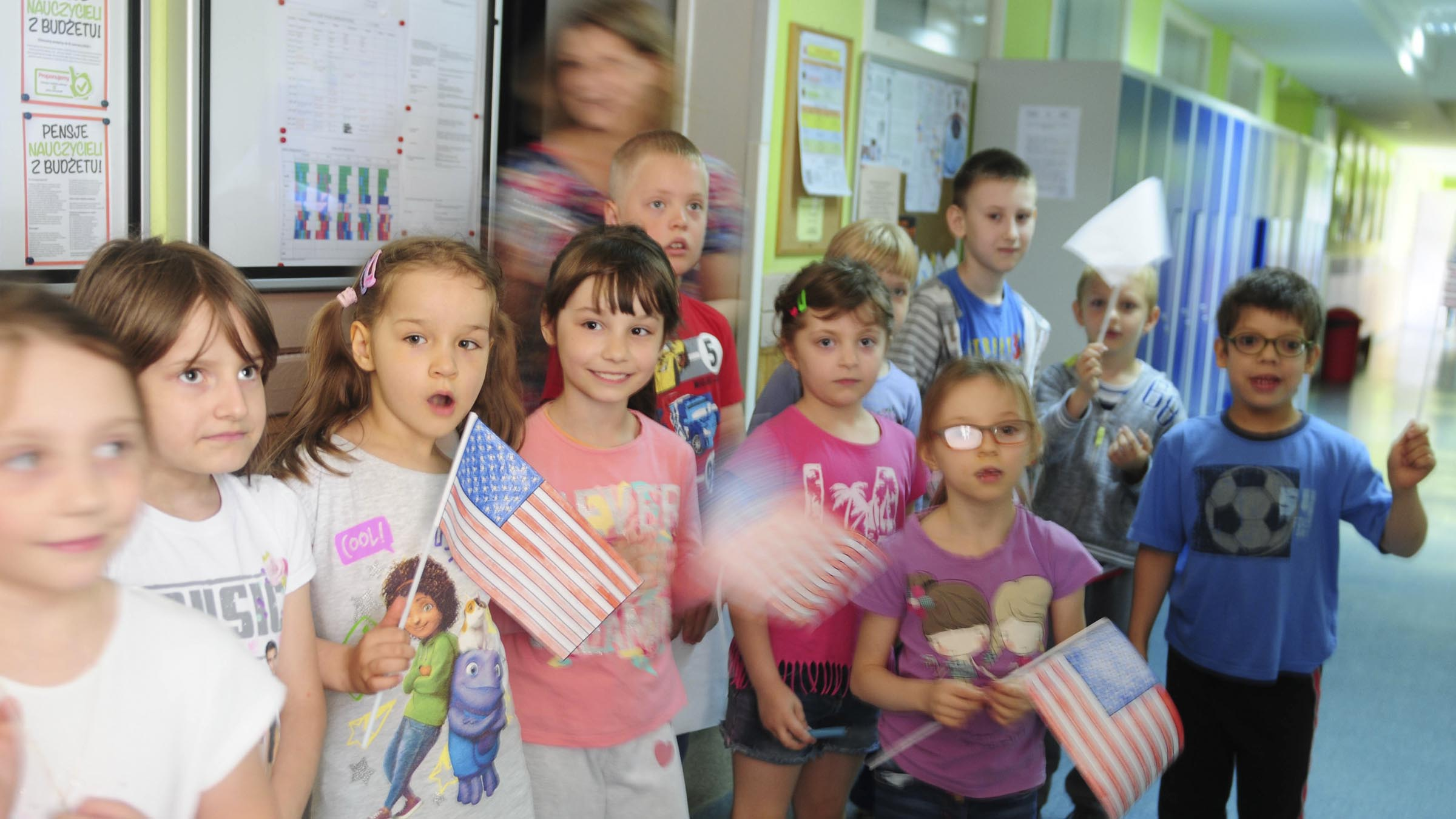 Young kids waving flags