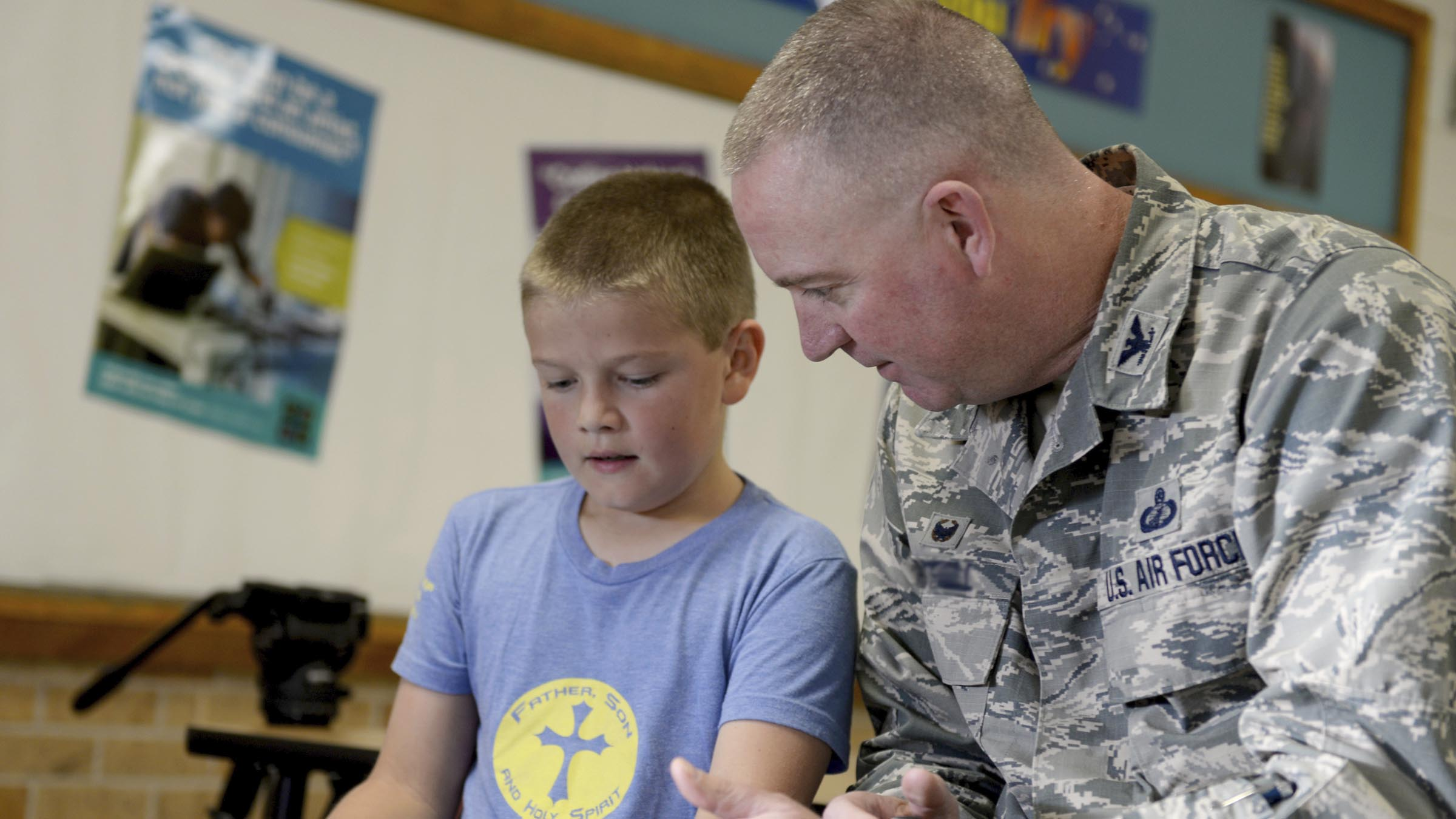 Service member and son working together
