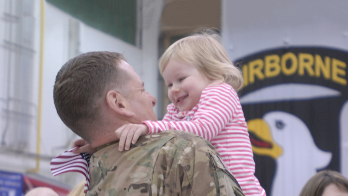 Service member and his daughter