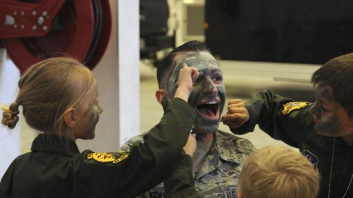 U.S. Air Force Airman gets his face painted during a camouflage face painting activity