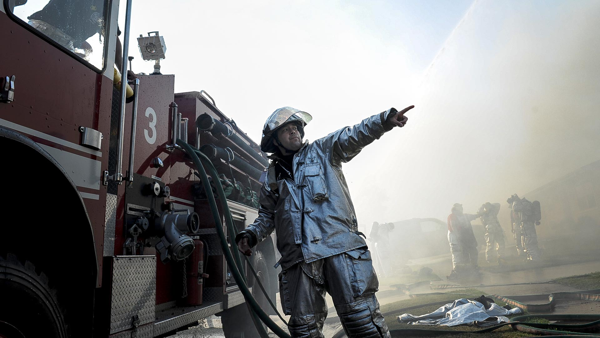 firefighter pointing at blaze