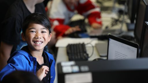 Young boy learning on a computer