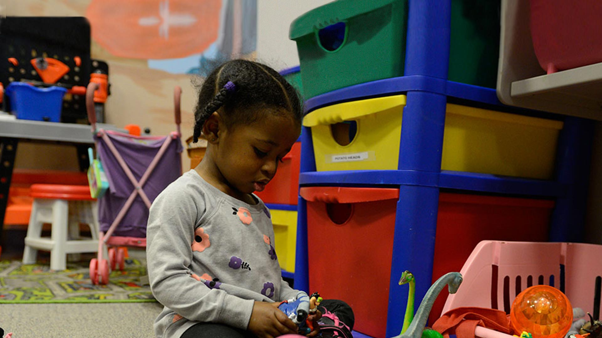 Young child playing in child care center