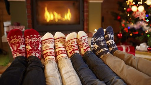 Family relaxing with holiday socks
