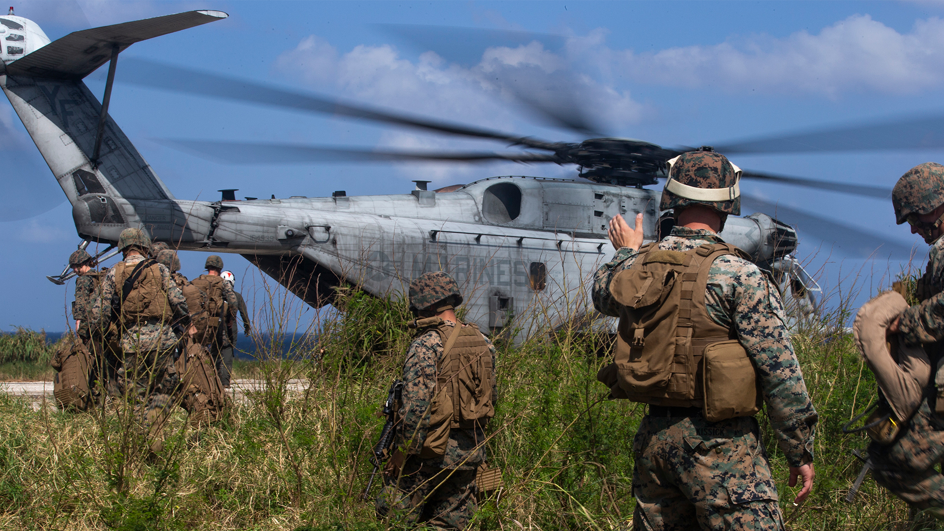Marines preparing helicopter for deployment