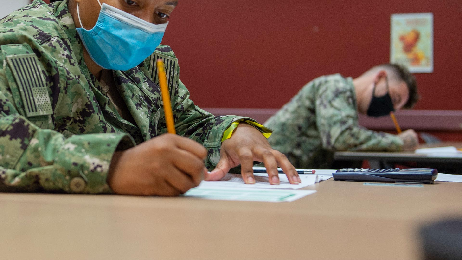 Navy officers testing in classroom