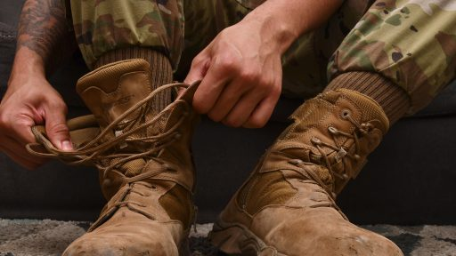 Service member tying boots