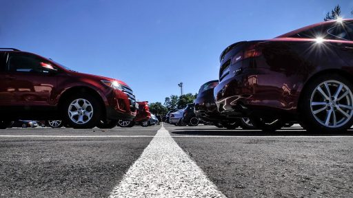 A row of cars parked in a lot