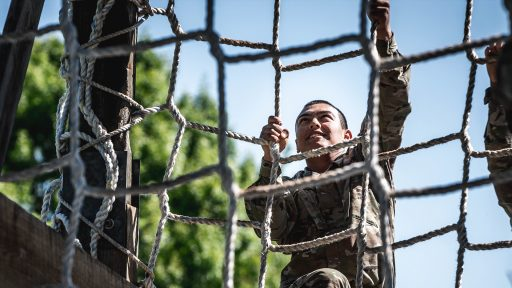 Trainee climbing on the obstacle course