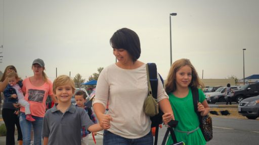 Military wife takes walks with her children to the first day of school.