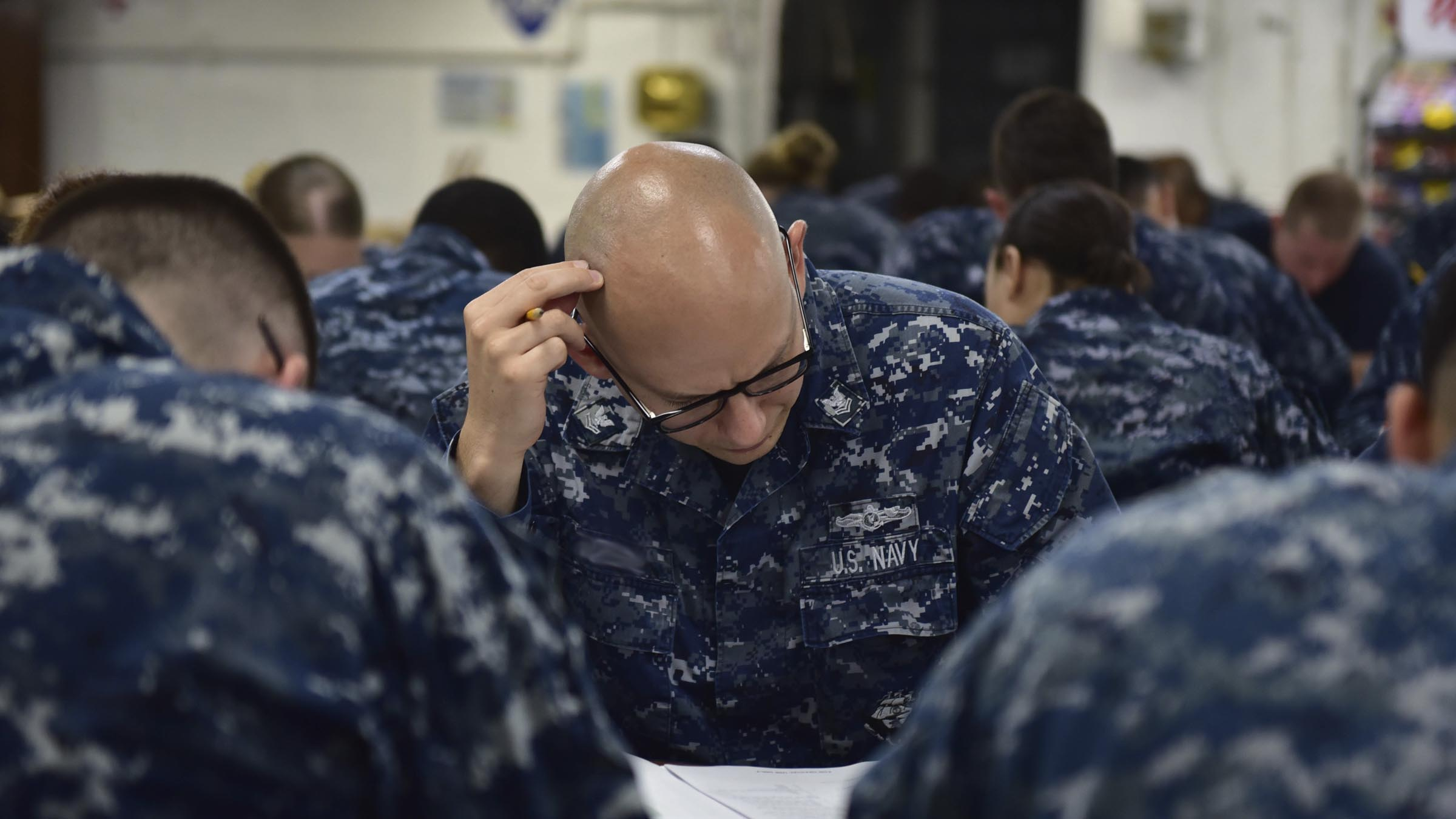 Service member taking advancement exam