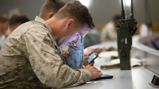 Marine looks at tablet