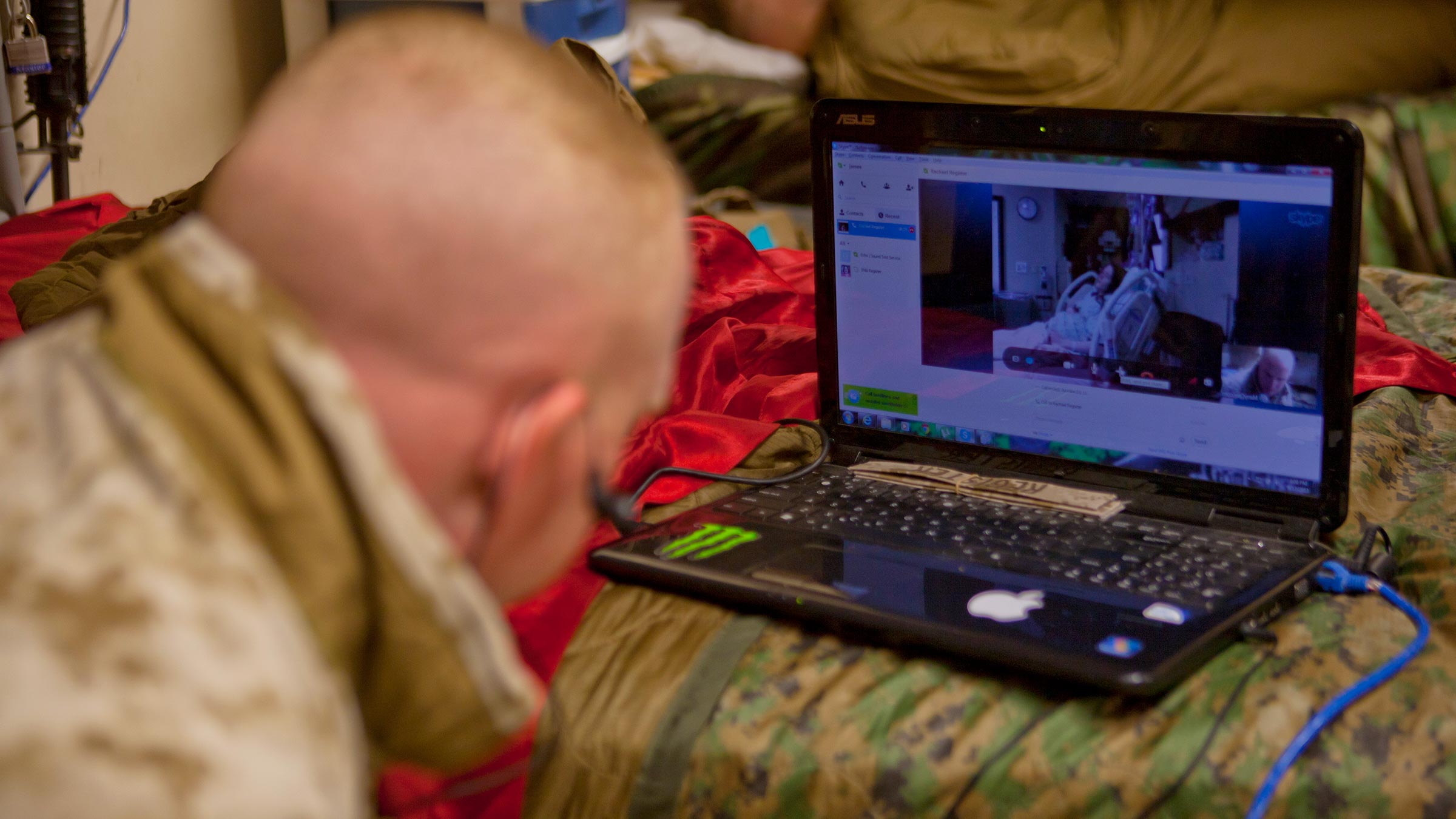 Service member watches video of child being born
