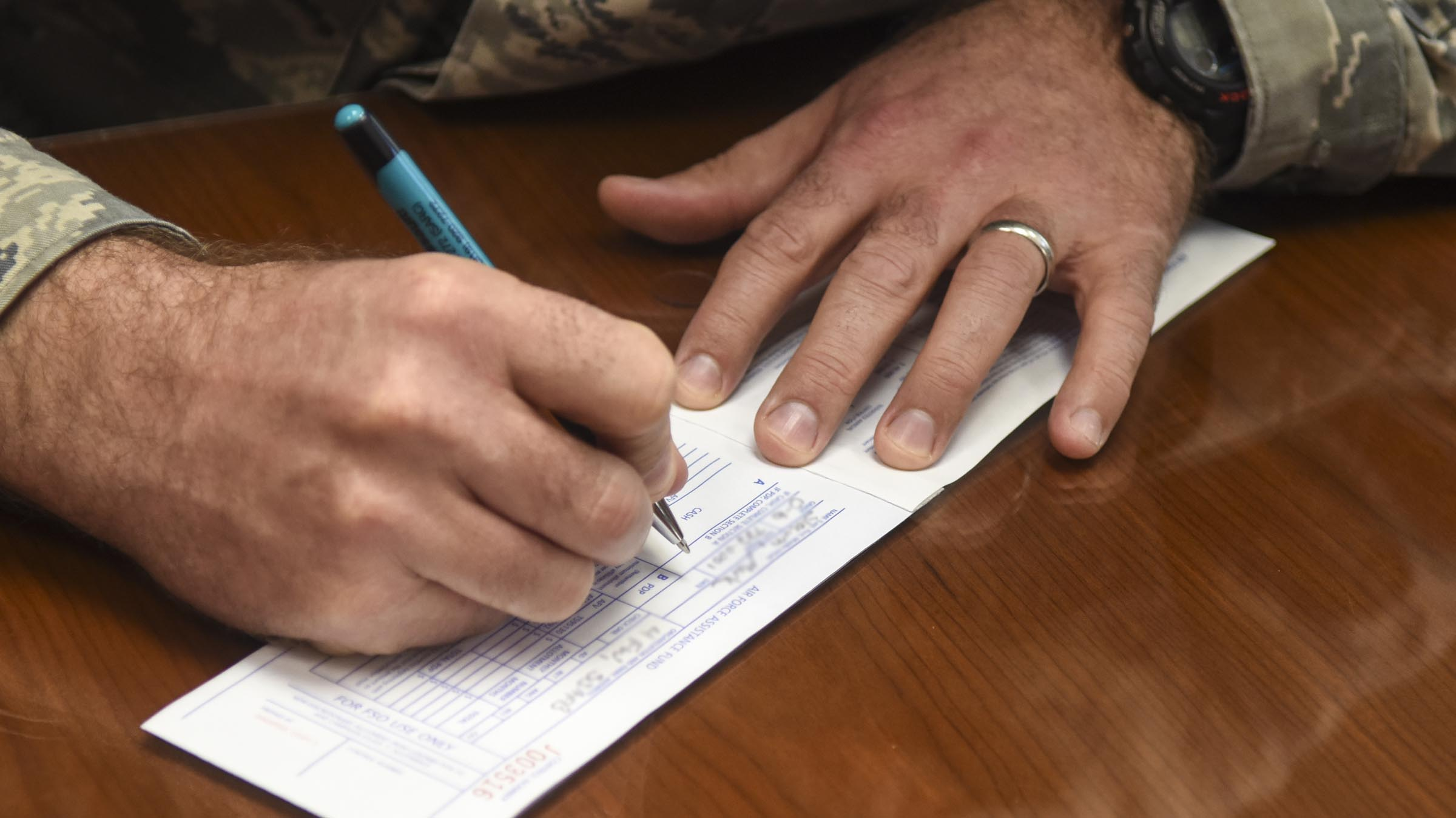 hands filling out paperwork