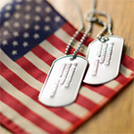Dog tags on top of an American flag