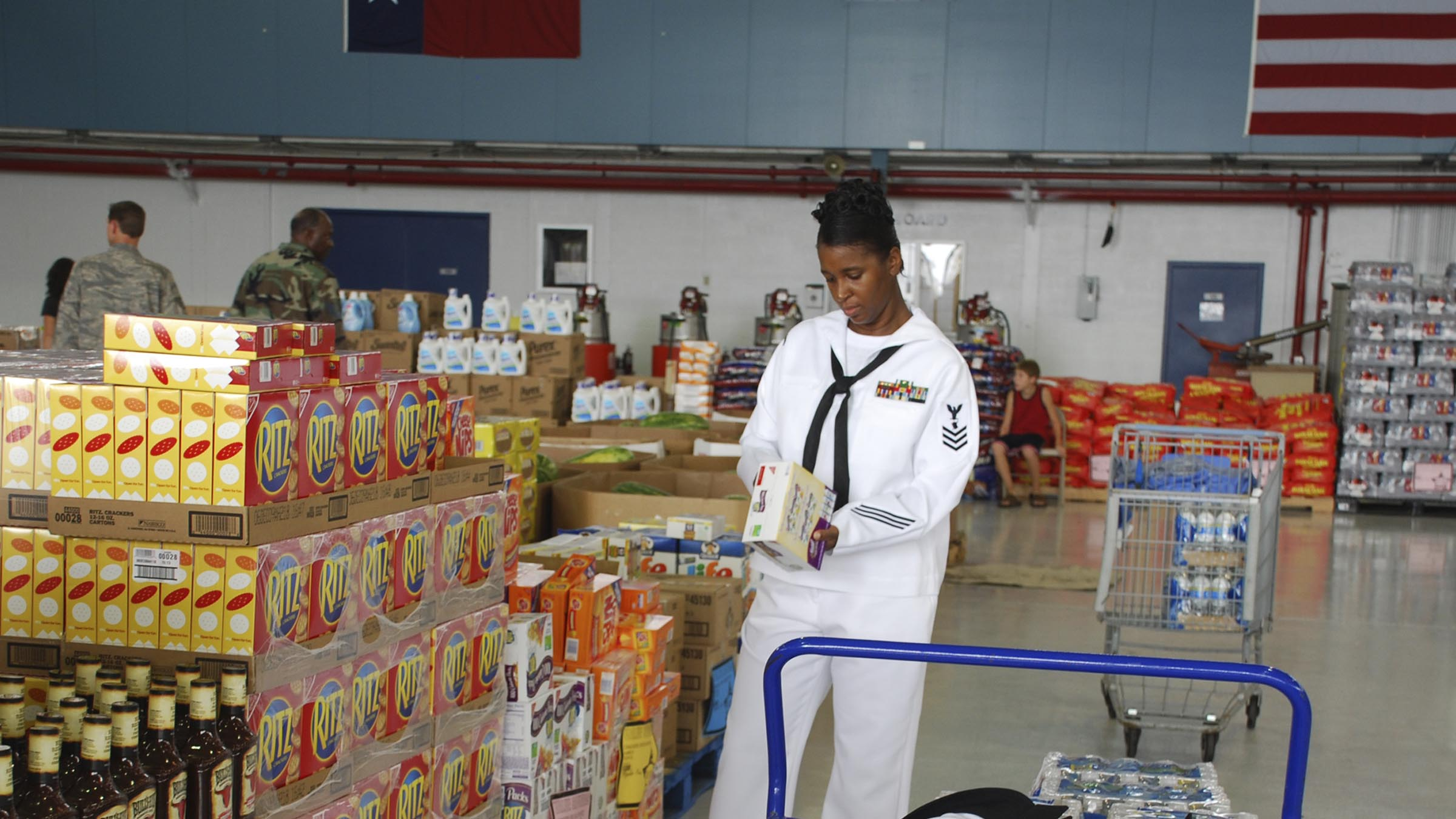 Service member checks nutritional information on box of crackers.