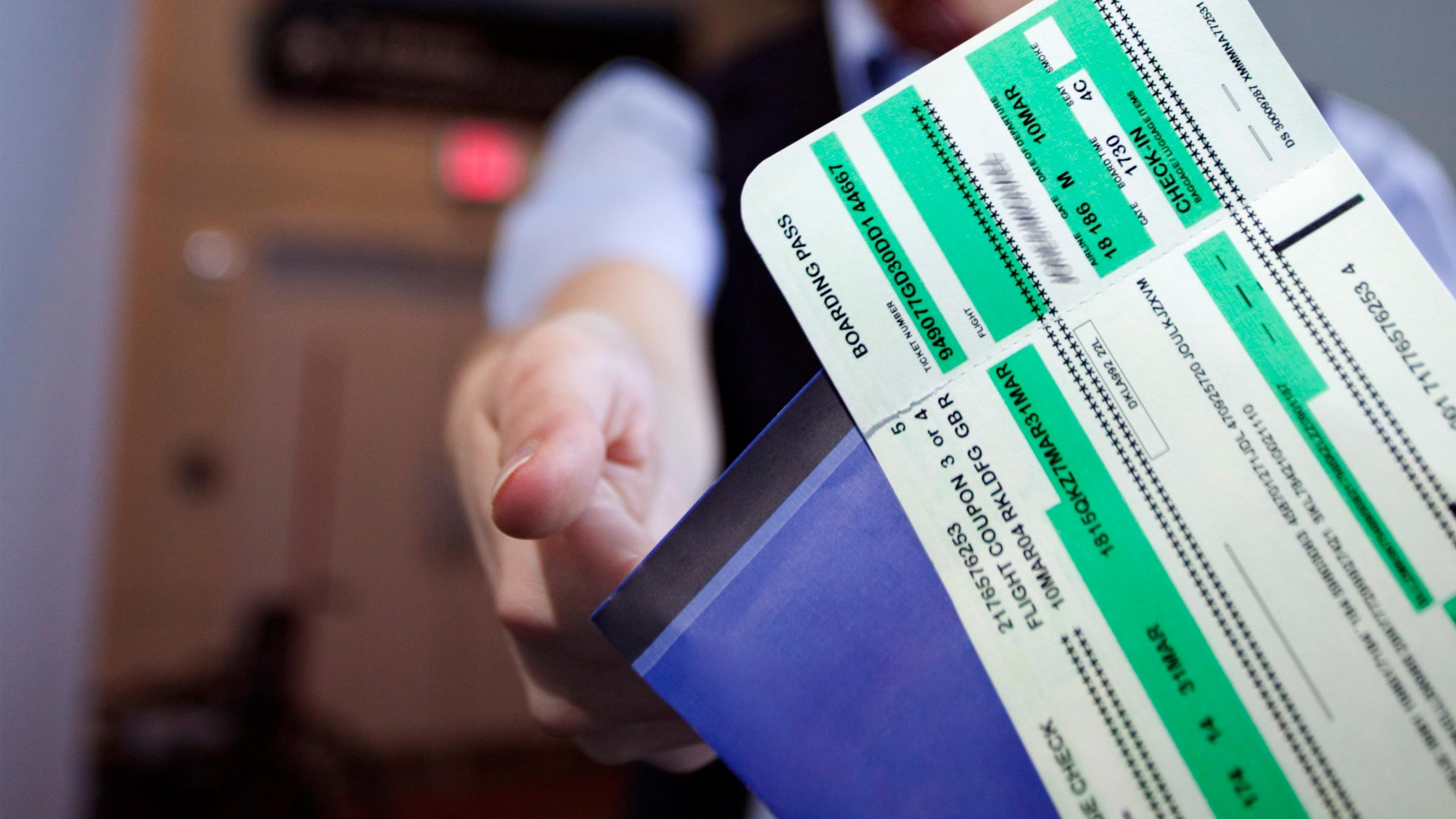 Hand reaches out to accept boarding pass