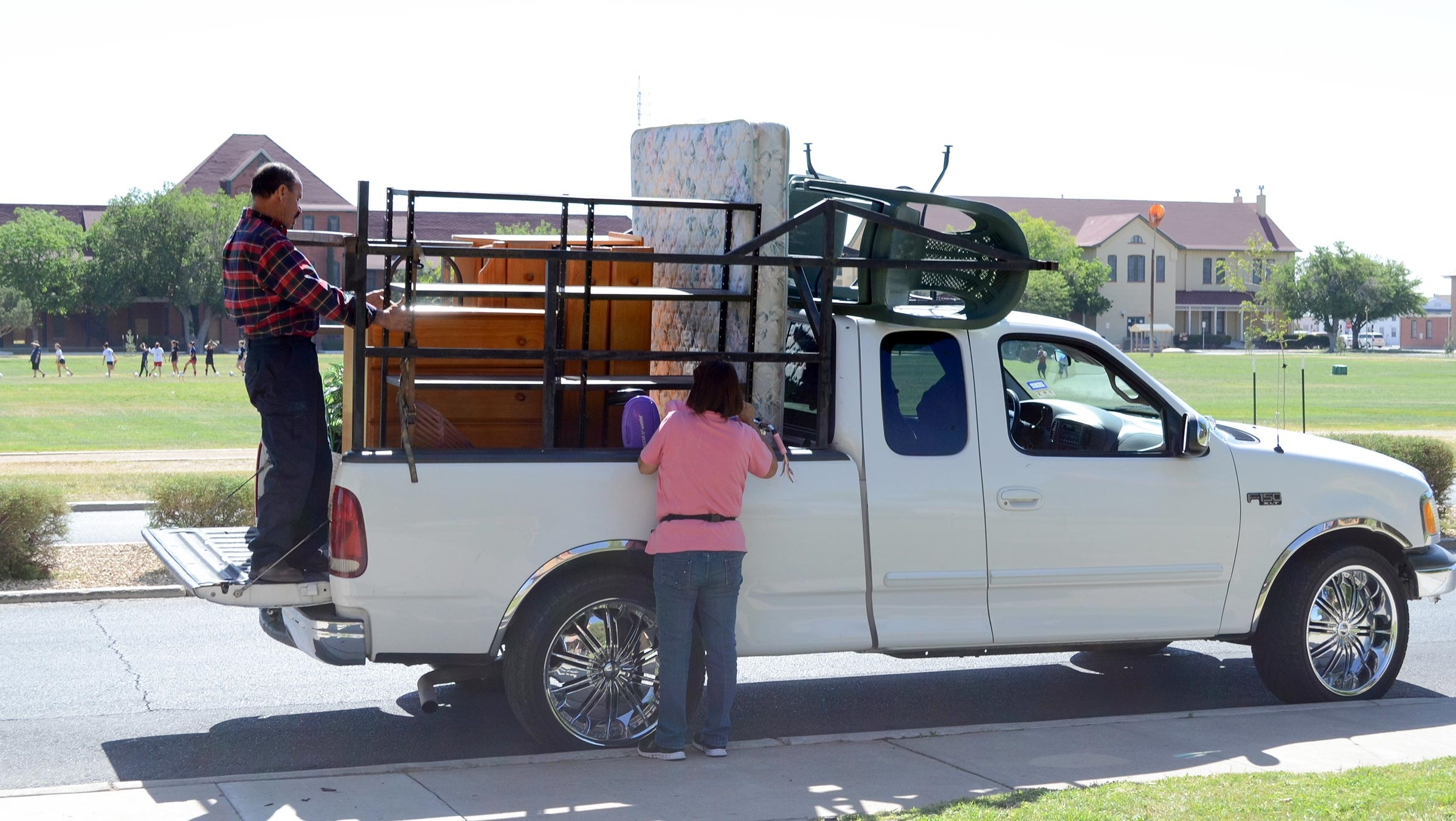 Family packs their belongings on a truck