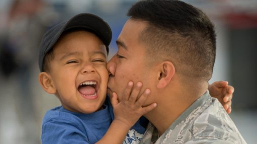 Service member father kisses son