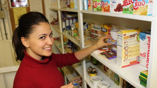 Woman removing item from shelf