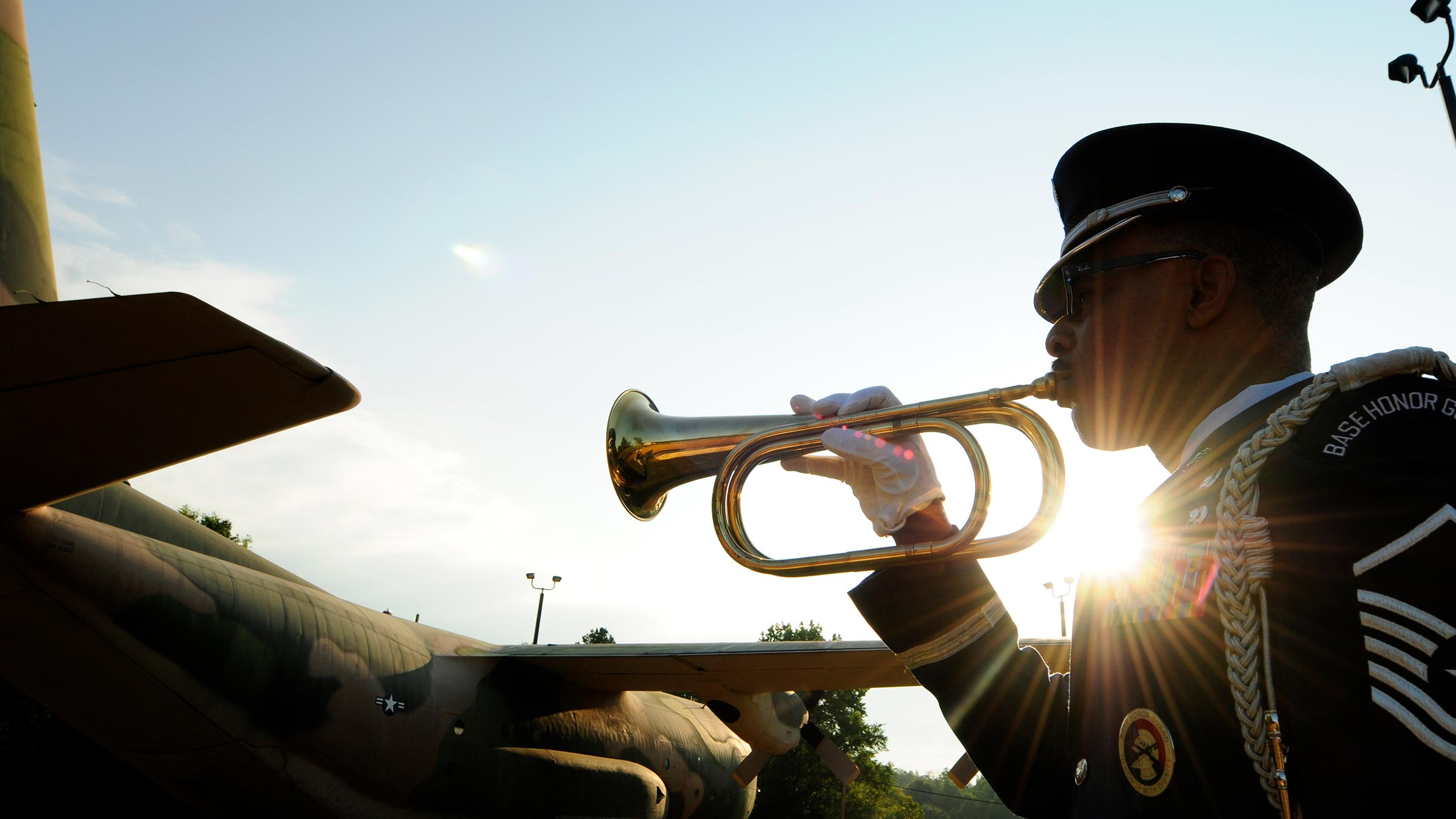 Air force member plays taps on his bugle