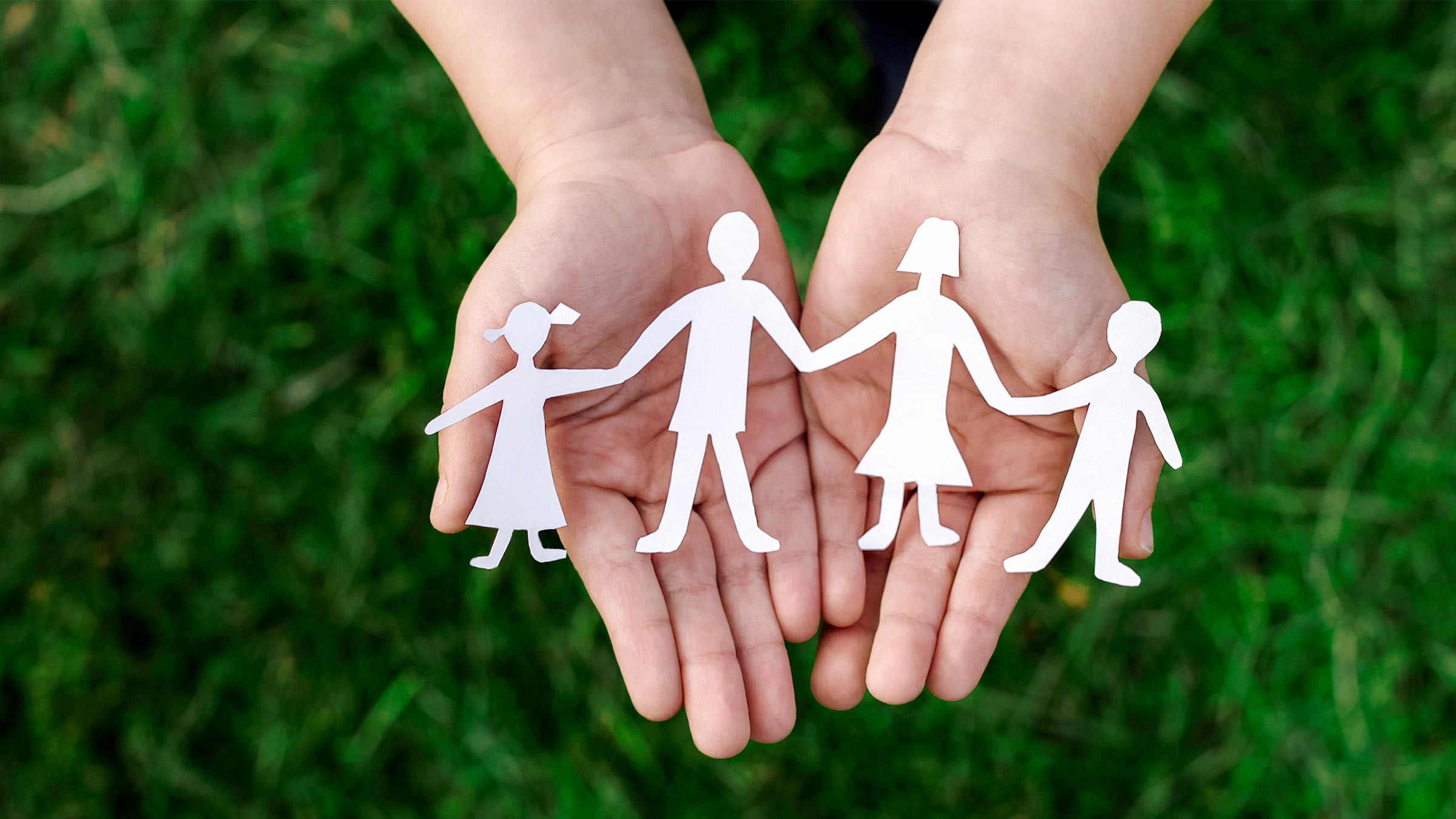 Child hold cut out paper of family holding hands