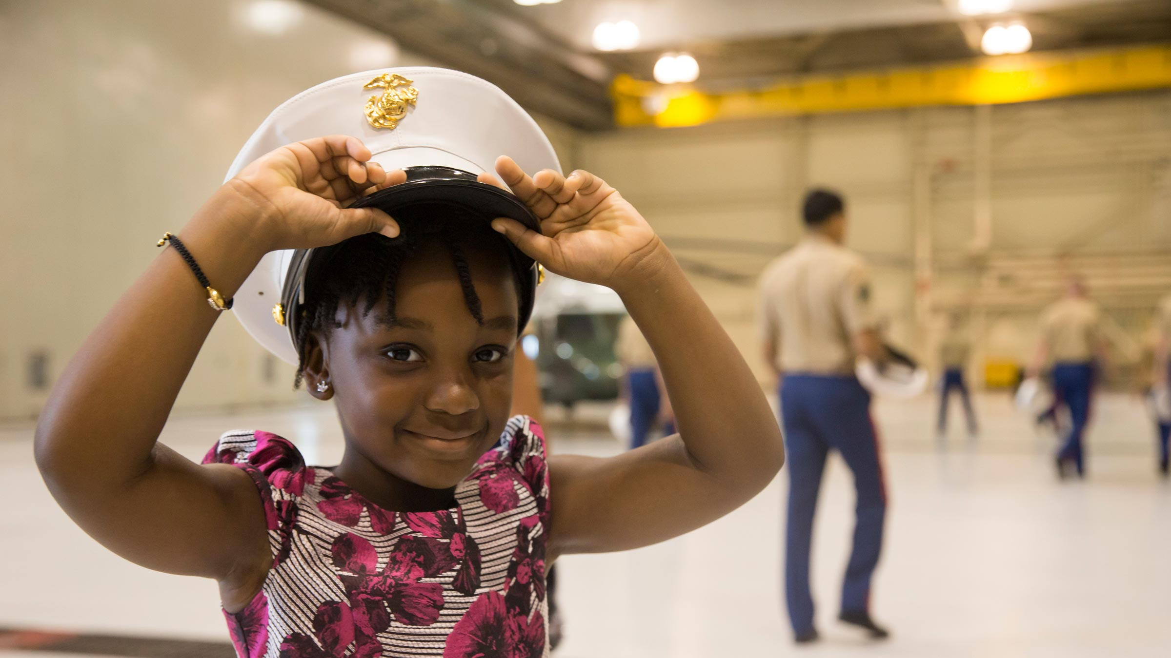 Girl put on naval officers hat