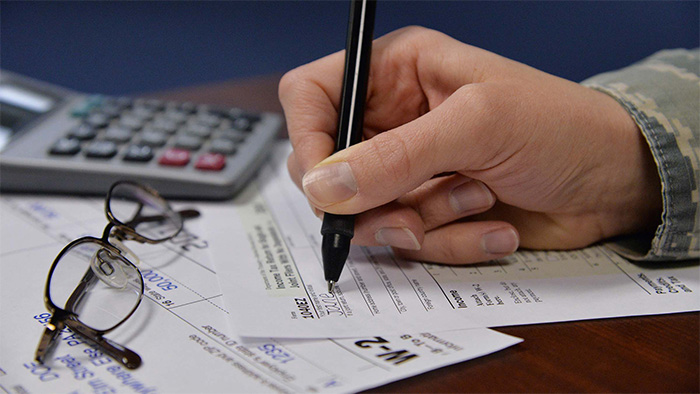 A person filling out tax forms