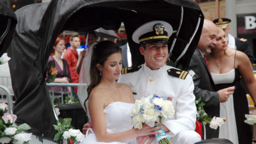 Bride and groom on a carriage ride