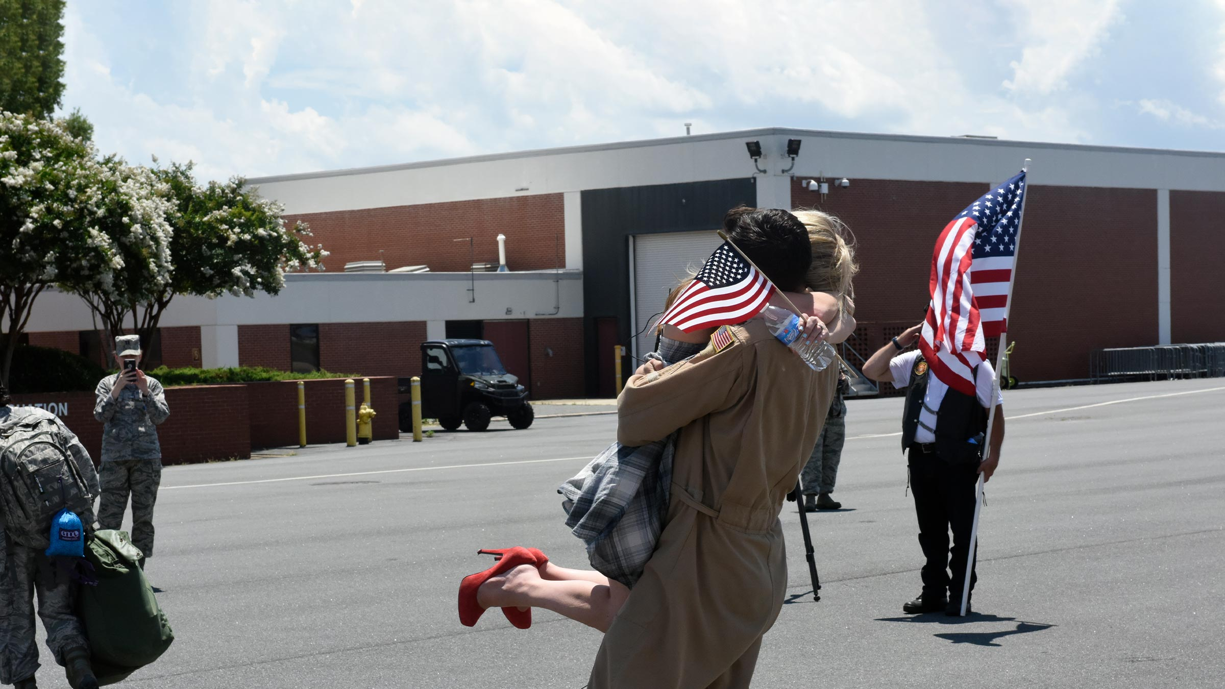 Service member hugs wife after returning from deployment