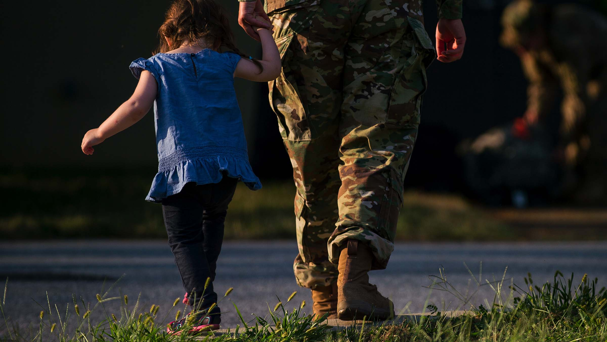 A U.S. Army Reserve military police soldier holds hands with her niece.