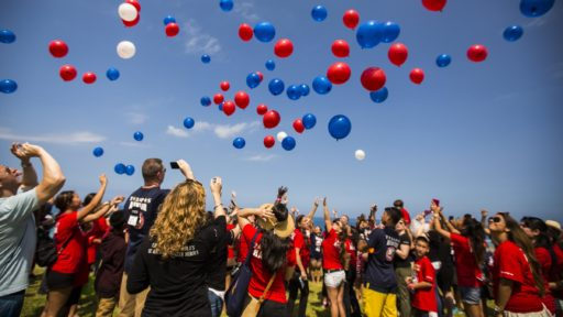 Family members release balloons to honor fallen marines