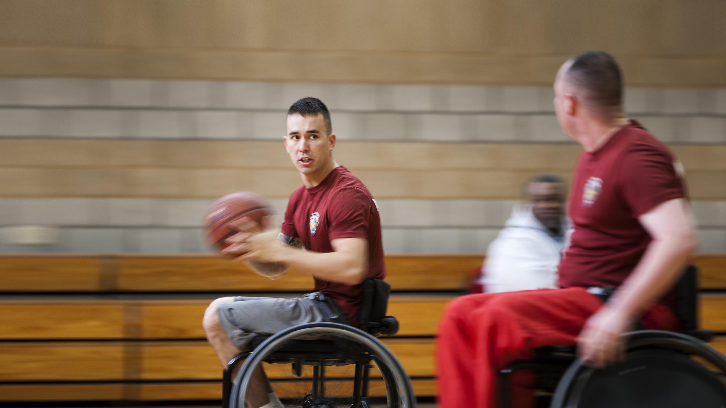Men in wheelchairs playing basketball