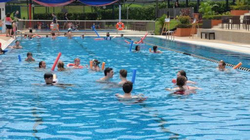group of people in recreation center pool