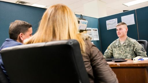 A tax preparer works with customers.