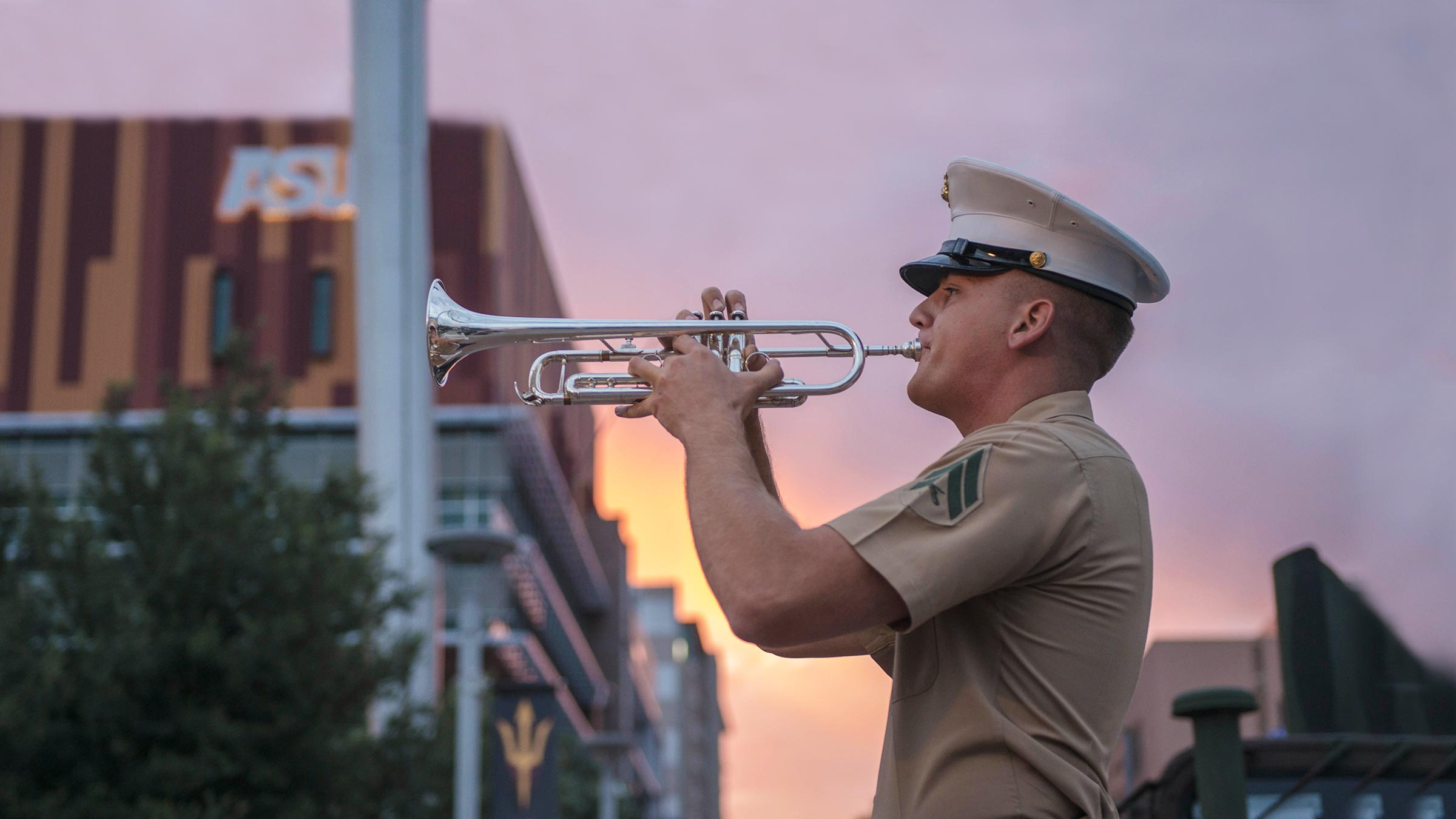Marine playing bugle