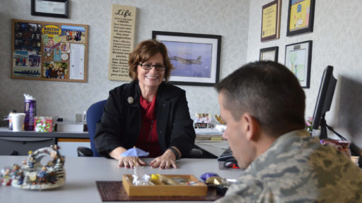Mental health specialist speaks with a service member in her office.