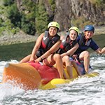 A group of people tubing on the water