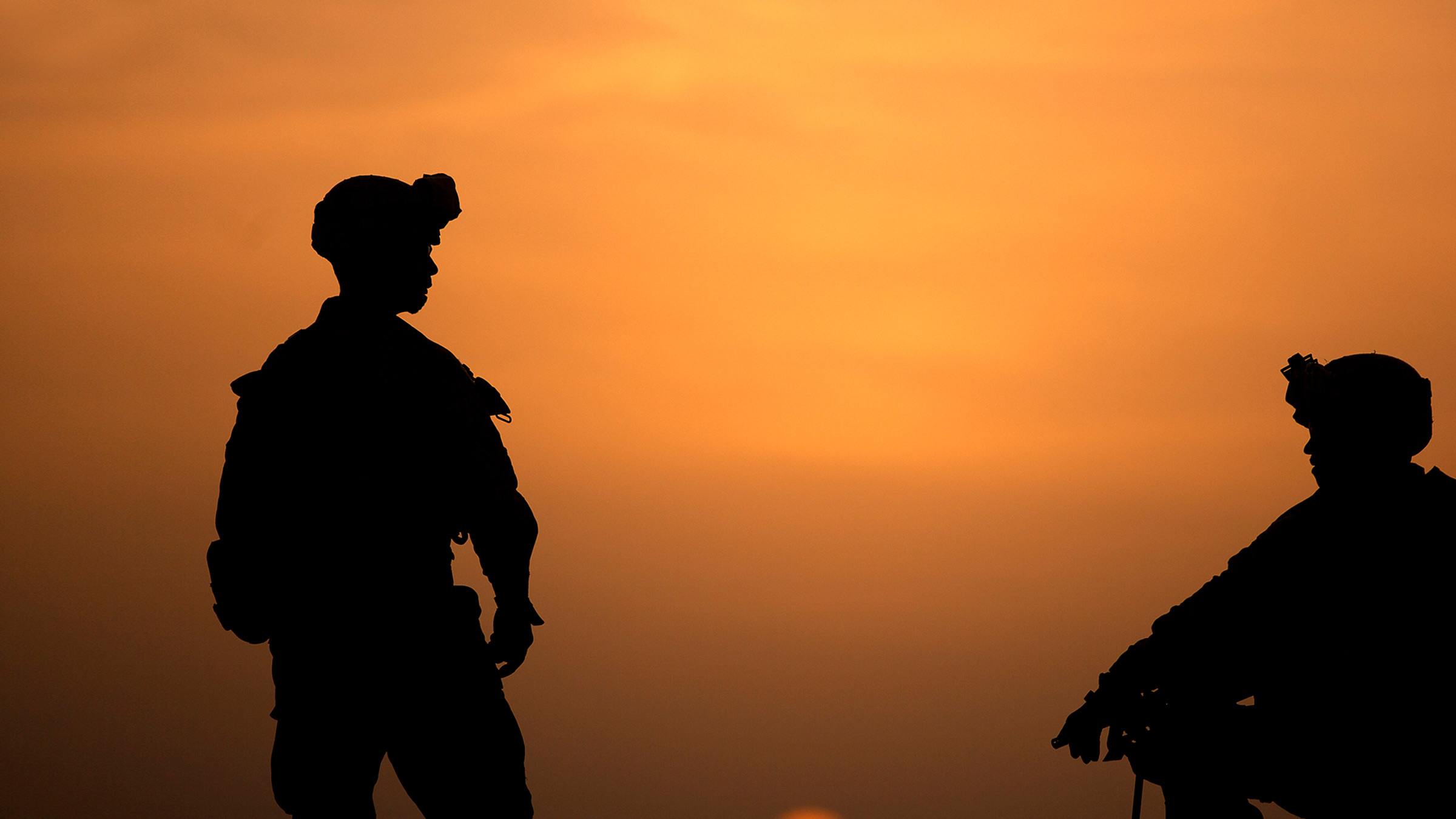 Two soldiers talk
