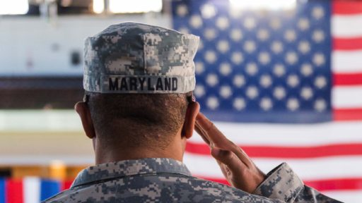 National Guardsman salutes the flag.