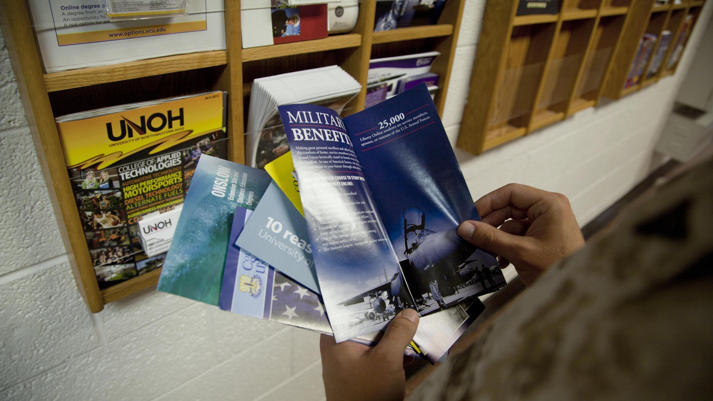 Service member looking at brochures