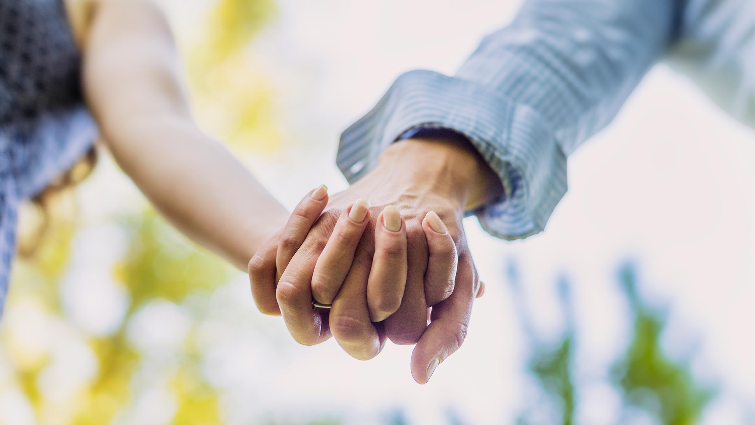 A man and woman holding hands.