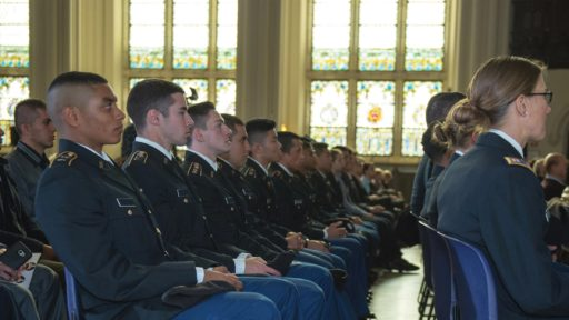 ROTC students sit and listen to a speech.