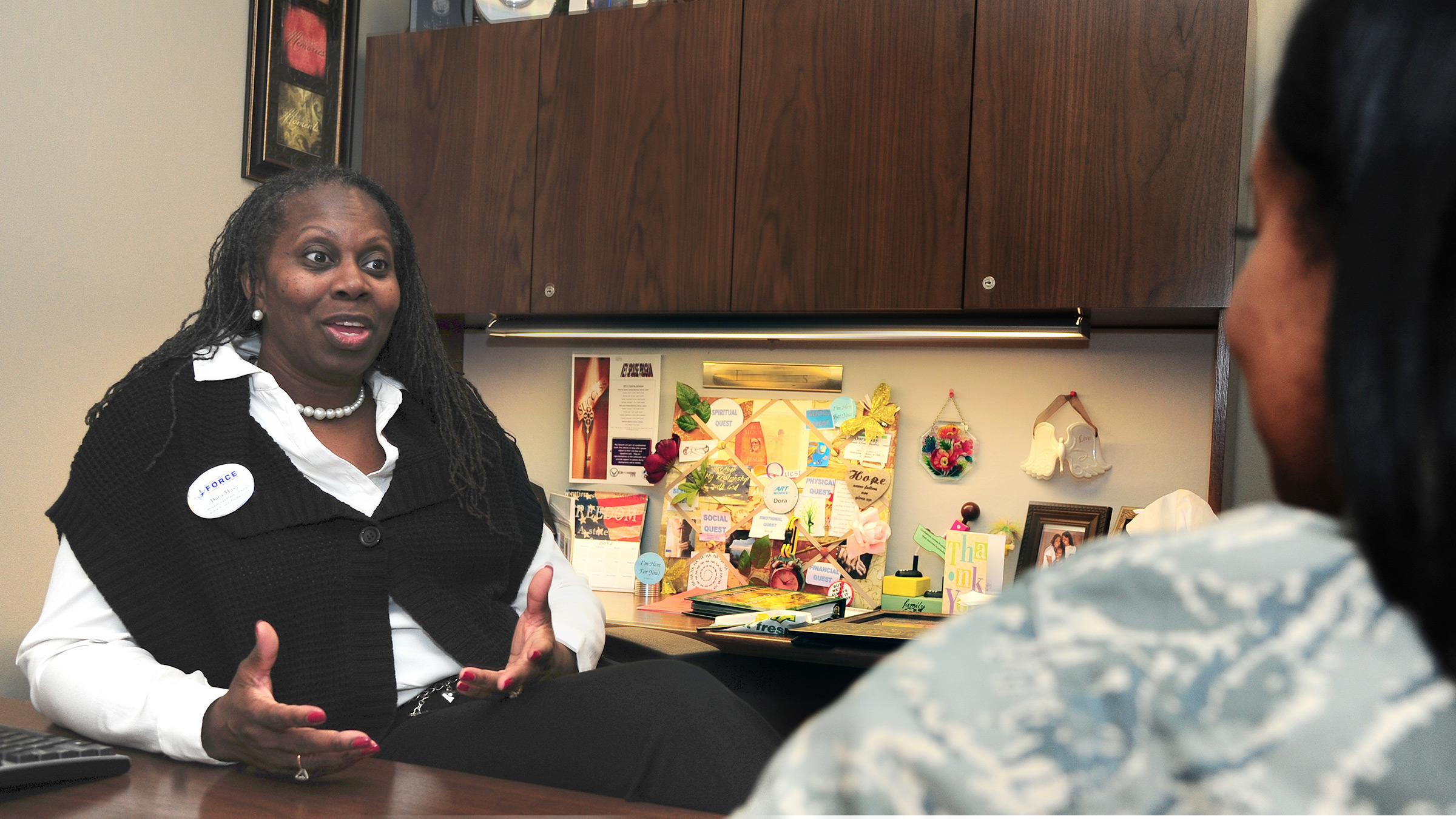 Community readiness consultant talks with a service member