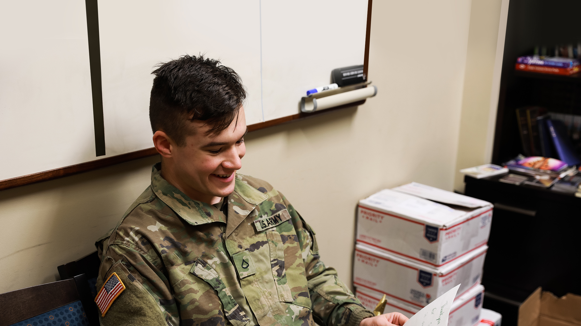 Service member receiving a care package.