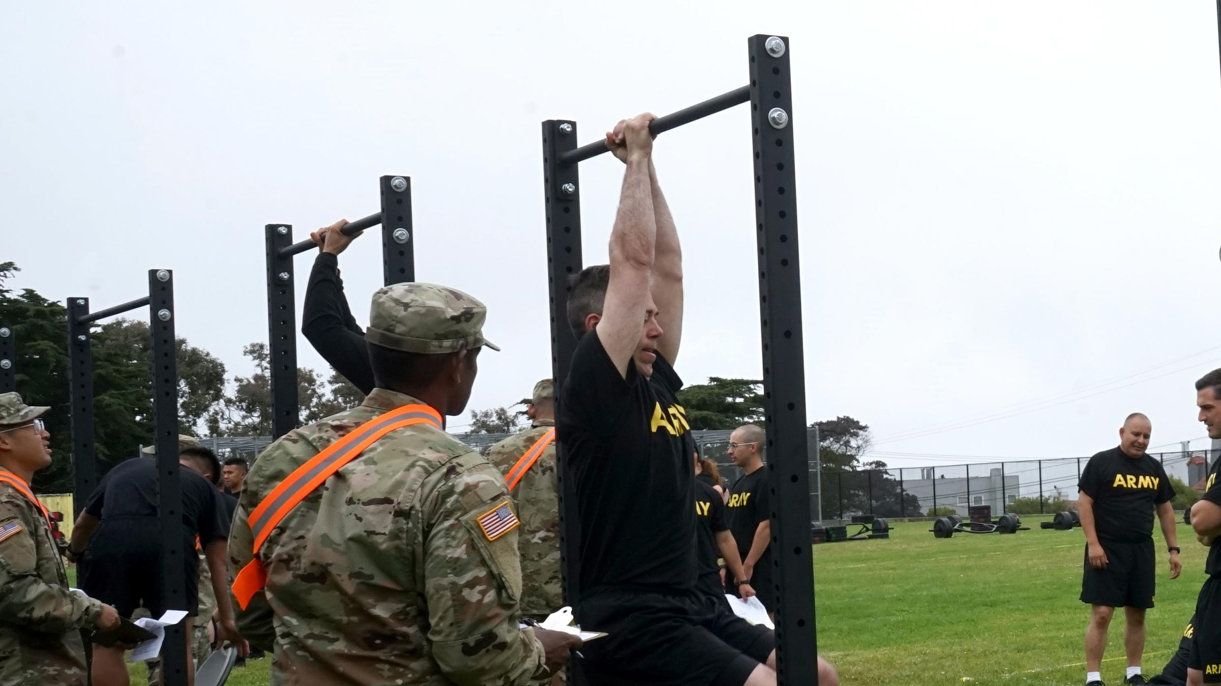 Service members do pull-ups during training