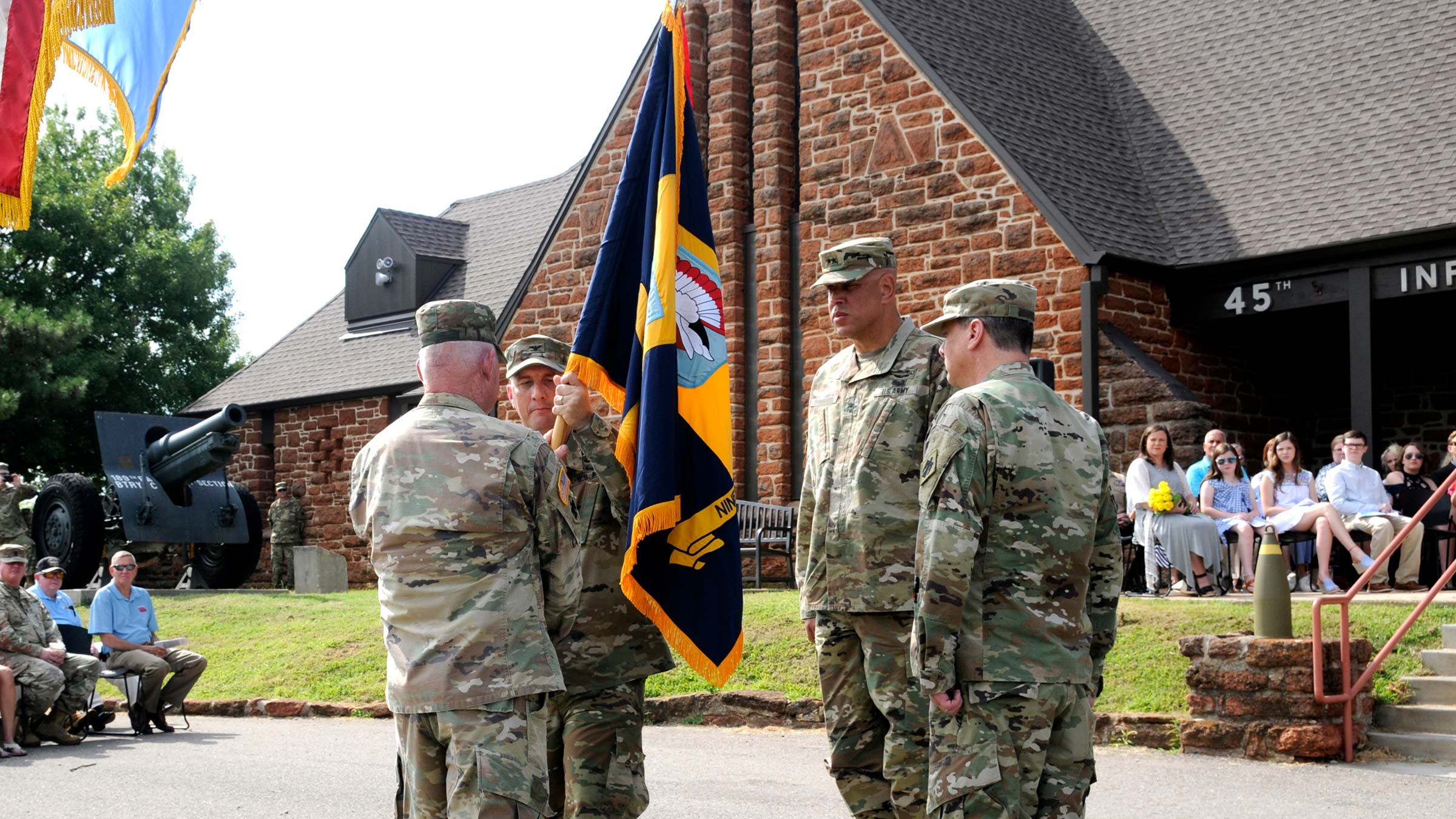Service members holding a flag