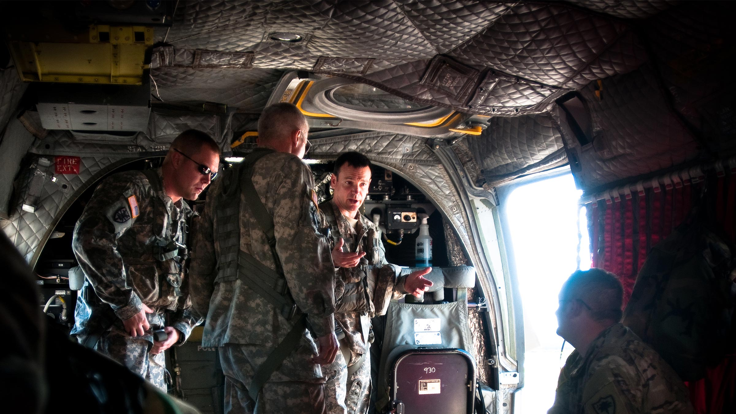 Service members in helicopter