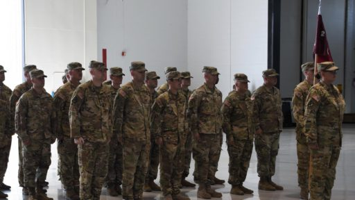 Service Members Stand in Line